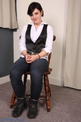 Cuffed to a chair. Very very tight waist chain and cuffs.