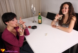Drinking and playing a dice game in handcuffs