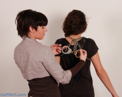 Locking Anahi in a handcuff shoulder harness