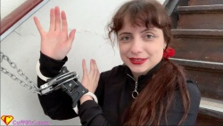 Cuffed on the stairs